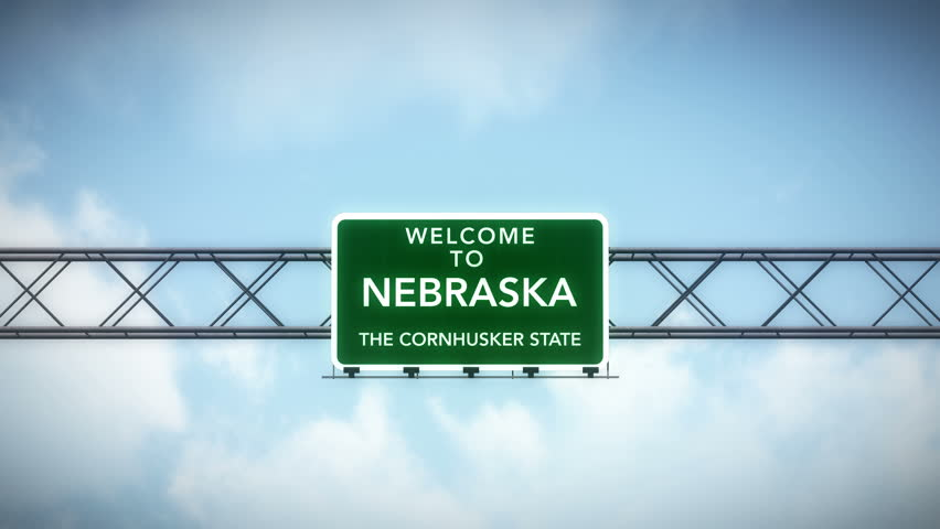 4K Passing under Welcome to Nebraska State USA Interstate Highway Sign with Matte Photo Realistic 3D Animation 4K 4096x2304 ultra high definition