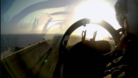CIRCA 2010s - POV shot of a fighter jet taking off from an aircraft carrier.
