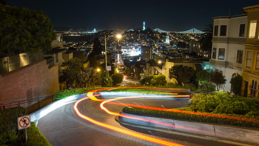 Time lapse looking down Lombard street in San Francisco. The Bay Bridge and Coit Tower can be seen in the background. Camera view centered on the street. | Shutterstock HD Video #9199274