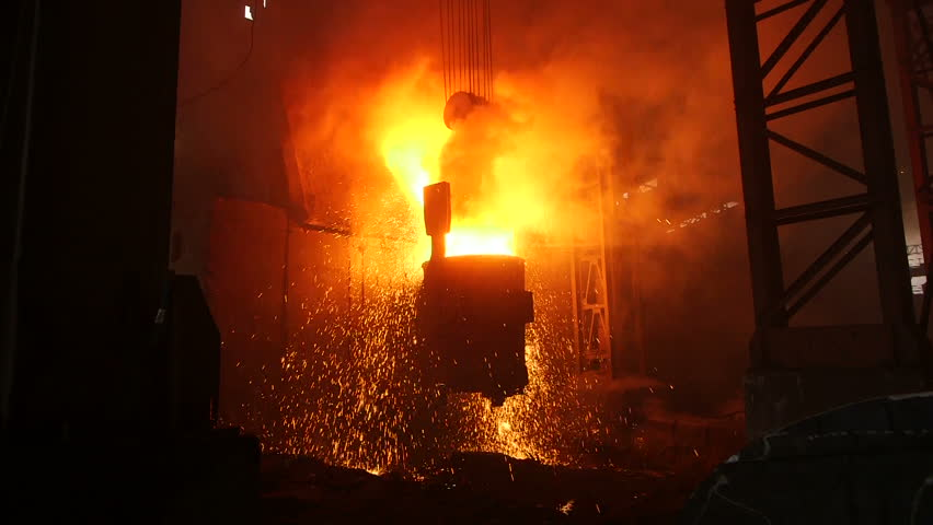 Foundry plants. Melting of the metal at the factory. The liquid metal is poured into the smelting stove. Splashes of molten metal at the plant. | Shutterstock HD Video #9220796