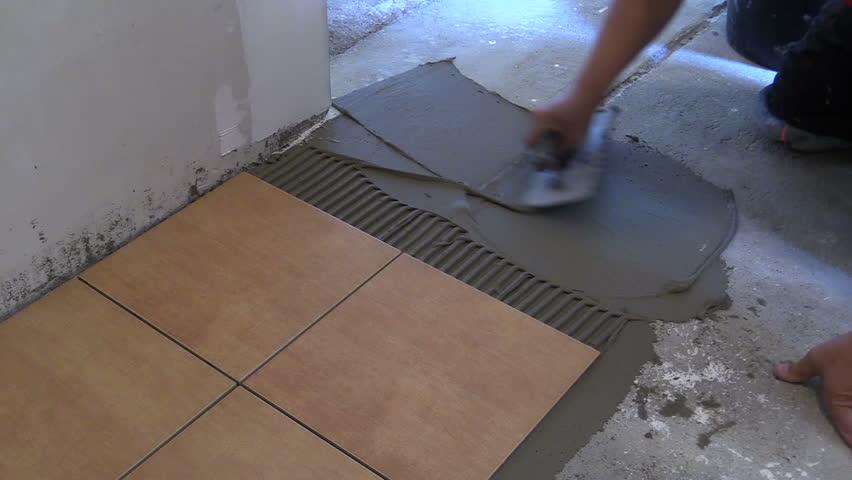 Man Hand Spreading Adhesive Material Laying Ceramic Floor Tiles Closeup Shot On Canon Xa25
