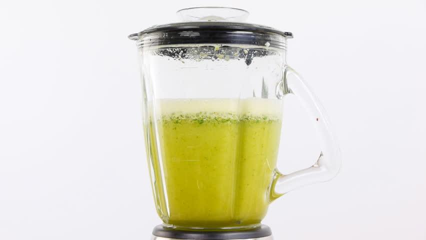 preparing green cocktail in blender
