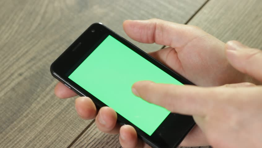 Hand with a smartphone with green screen | Shutterstock HD Video #9292334