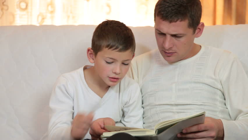 Father and Son Reading Book Stock Footage Video (100% Royalty-free) 9293456    Shutterstock