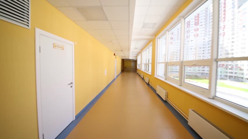 Stock Video Clip Of Yellow Long Hallway With Big Windows