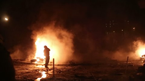 UKRAINE, KIEV, JANUARY 19, 2014: Thousands of anti-government protesters clashed with riot police, burning police buses and attacking with stones, sticks and fires after tough laws were passed