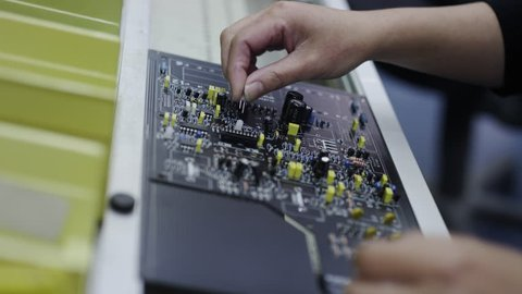 Building Circuit Boards in Electronics Factory - Assembly line of LEDs, Transistors and other Electronic components being installed