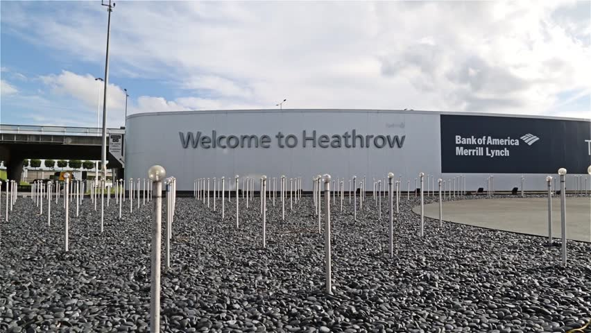 "Heathrow Airport, London, UK, 25/03/2015 Zooming onto the ""Welcome to Heathrow"" sign at the entrance of Heathrow Airport"