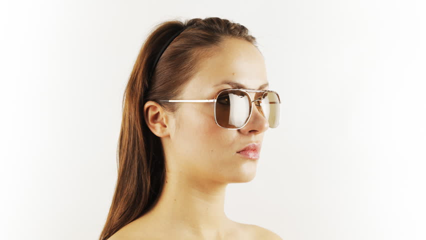 Stop-motion of a pretty woman wearing different retro sunglasses | Shutterstock HD Video #934435