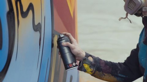 Slow motion graffiti painting on the wall, interior