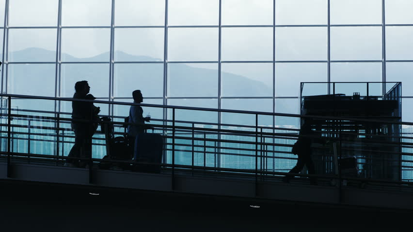 Silhouettes of Travelers and Commuter in Airport. People in airport.  | Shutterstock HD Video #9401216