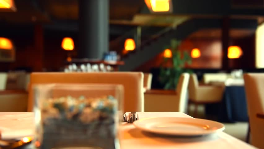 Dinner Table Background blur background : chefs cooking food in a restaurant kitchen stock