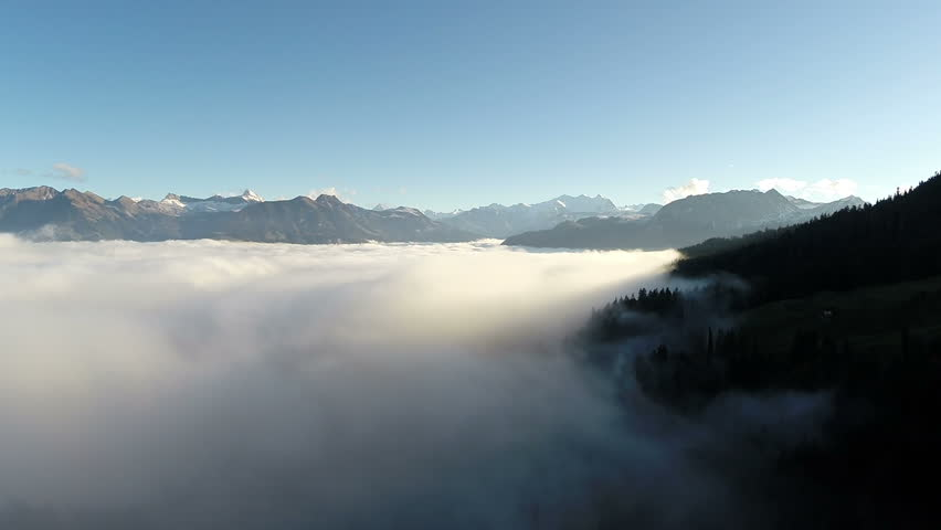 Aerial view of the last sun rays into a sea of fog, Switzerland | Shutterstock HD Video #9457406