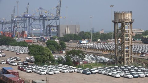 CHENNAI, INDIA - 26 NOVEMBER 2014: New Hyundai cars are parked for shipment overseas in the Chennai Port. Chennai is a big car manufacturing hub for both domestic and international brands.