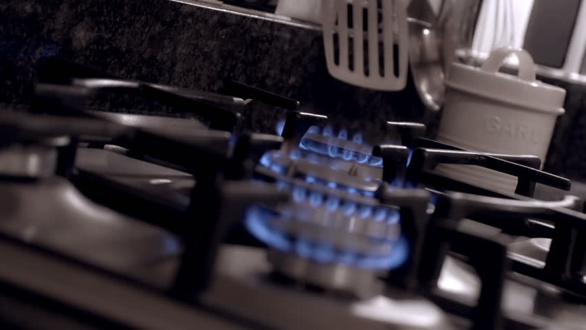 Domestic Male Checks On His Cooking In A New Kitchen. Filmed In A ...