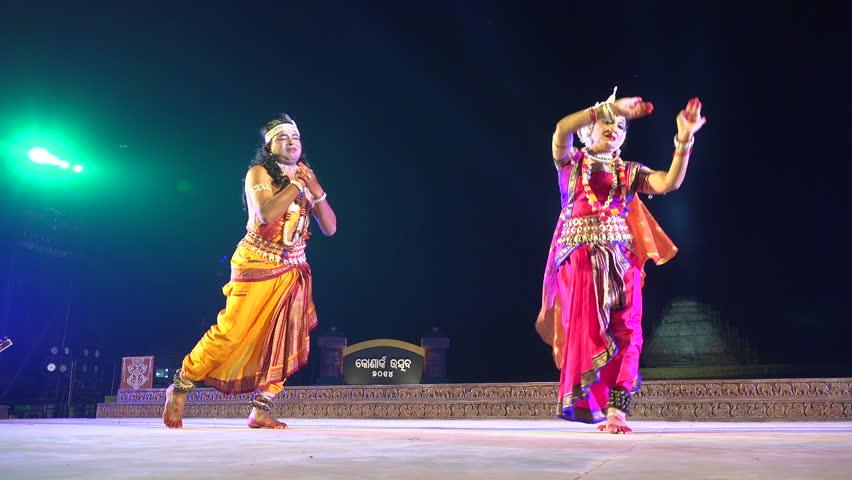 KONARK, INDIA - 3 DECEMBER 2014: Two unidentified dancers on stage during the Konark Dance Festival in India.