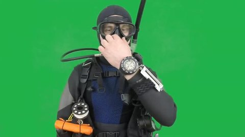 Diving sign- divemaster  shows sing  EQUALIZE PRESSURE  ,also a available on the green screen all of diving sings from course (open water diver)