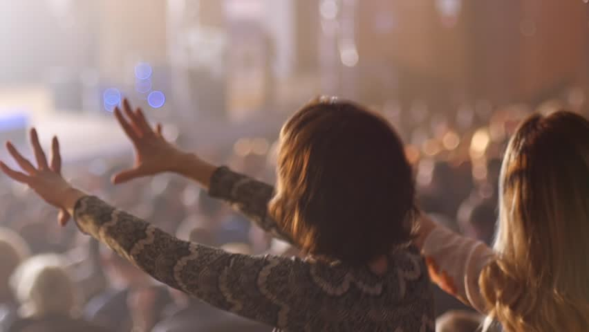 Dancing girl fan silhouettes on concert flashing light cheerful hands in air | Shutterstock HD Video #9528020