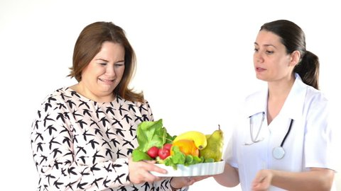 Doctor recommending diet to a fat woman. Fat woman crying.