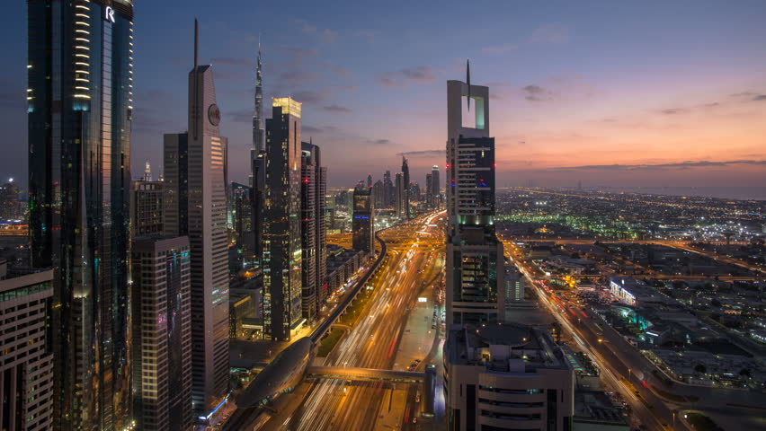 Dubai, United Arab Emirates - CIRCA DECEMBER 2014: Sheikh Zayed Rd, traffic and new high rise buildings along Dubai's main road, time-lapse #9547376
