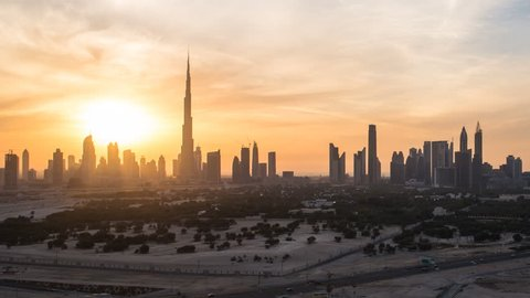 Dubai, United Arab Emirates - CIRCA DECEMBER 2014: Elevated view of the new Dubai skyline, the Burj Khalifa, modern architecture and skyscrapers on Sheikh Zayed Road, time-lapse