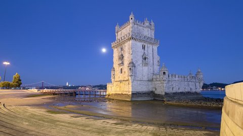 Lisbon, Portugal. Belem Tower (Torre de Belem) is a fortified tower located at the mouth of the Tagus River timelapse hyperlapse with full Moon, lights turning on 4K
