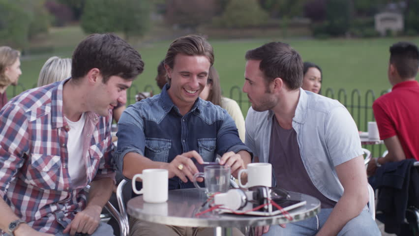 4K Happy Young Male Friends Pose To Take Their Own Photo At Outdoor Cafe