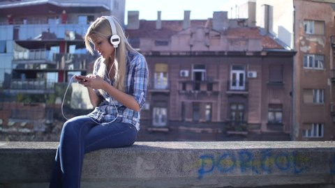 Woman listening music from smart phone mp3 player