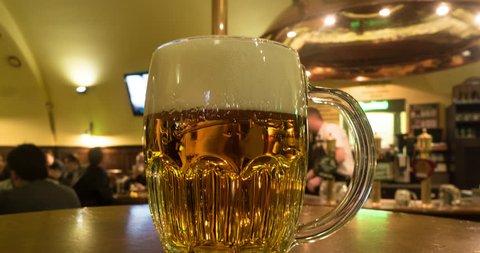 PRAGUE, MAR, 2015.  Timelapse of a beer in a bar.