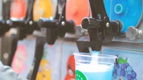 Slushie slush ice sugar drink poured from machine