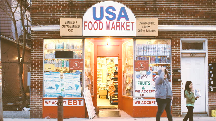 ATTLEBORO, MA - APRIL 16: Ethnic food market in low income urban neighborhood, signs read EBT food stamps are accepted, taken on April 6, 2015. Over 41 million Americans use government food stamps.