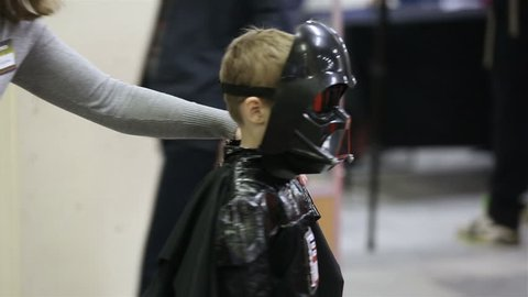 MOSCOW, RUSSIA - MARCH 28, 2015: Star Wars Cosplay show. Little boy dressed as Darth Vader during the festival Star Fans.