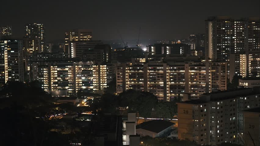 Apartment Building At Night singapore - march 2015 construction cranes on residental apartment