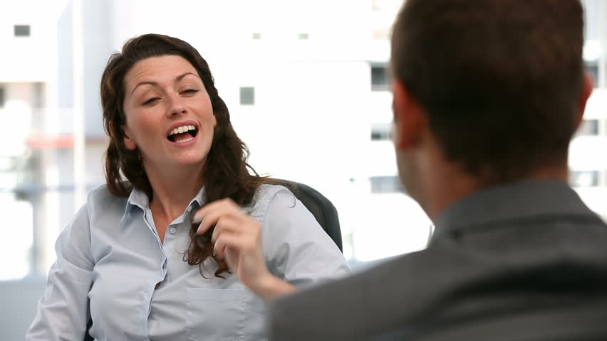 Appointment between a businesswoman and a businessman in the office   Shutterstock HD Video #967171