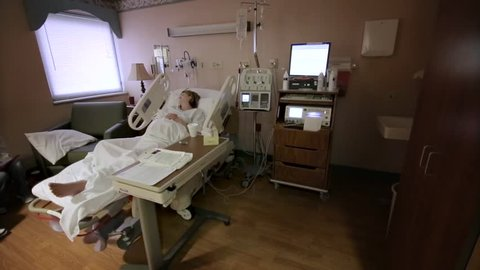 Pregnant Woman in Hospital Bed