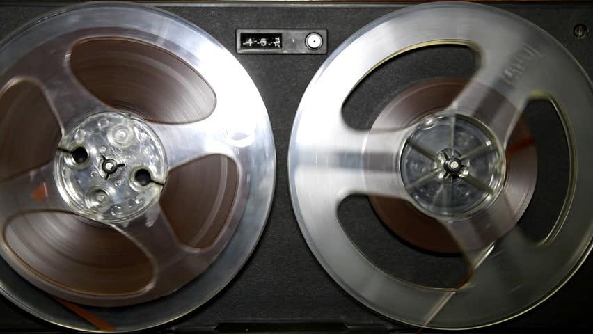 Old retro Reel Audio Recorder reels spinning
