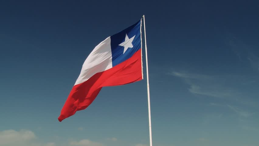 ARICA, CHILE - OCTOBER 20, 2013: National flag of Chile waves at the wind at the Morro de Arica hill on October 20, 2013 in Arica, Chile.