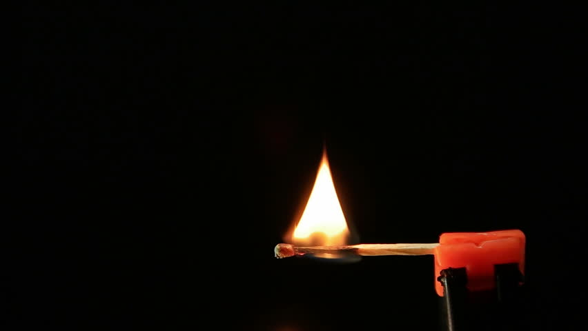 Matchstick igniting against black background 06 | Shutterstock HD Video #9705836