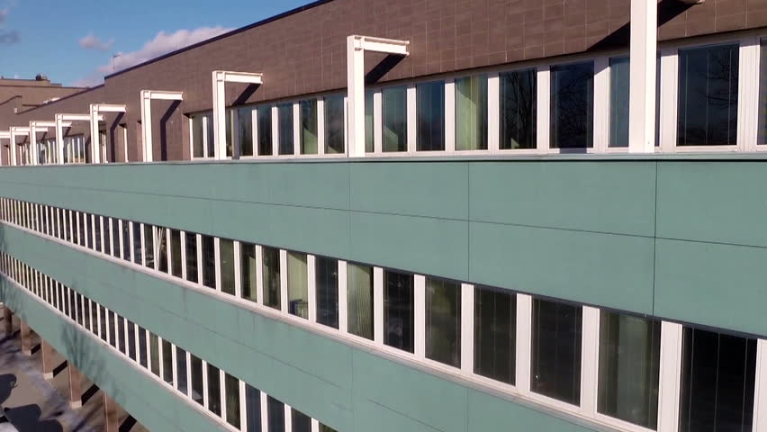 Aerial exterior shot of a modern office building in Europe - Establishing Shot