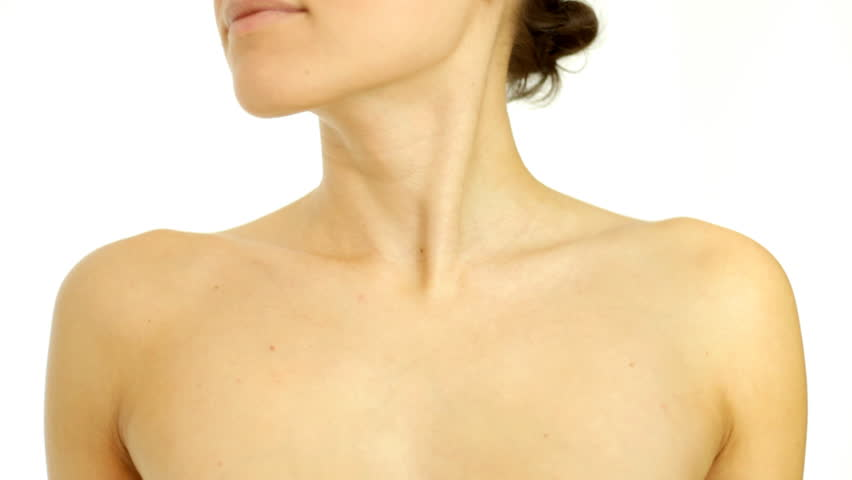 Woman gently touching her neck, isolated on white