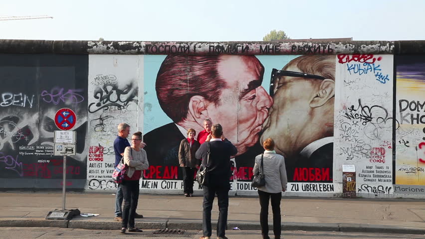 BERLIN - OCTOBER 4, 2014: The Berlin wall with grafitti on October 4, 2014 in Berlin, Germany. It was a barrier that existed in 1961-89 to completely cut off West Berlin from surrounding East Germany.