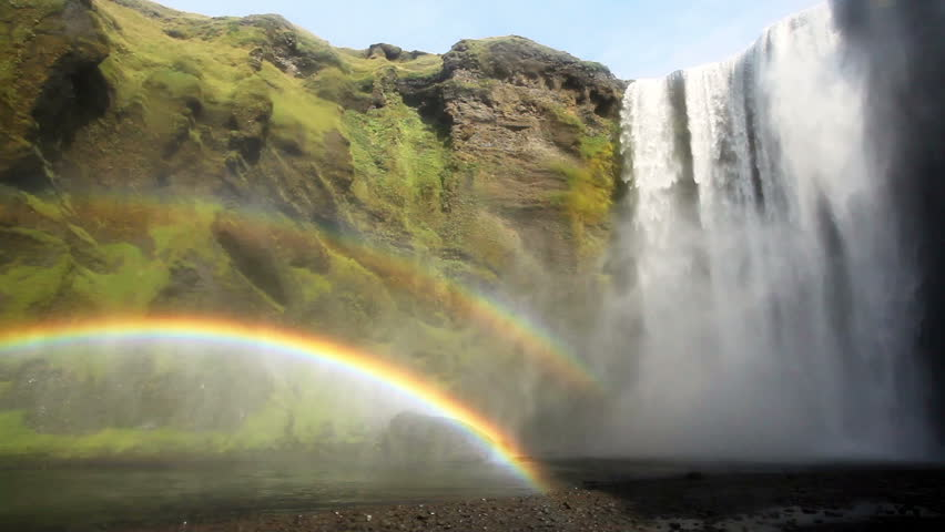 Famous and photography friendly waterfall in the southern part of Iceland, just south of Eyjafjallajokull. Extraordinary spectacle, Skogafoss with a double rainbow