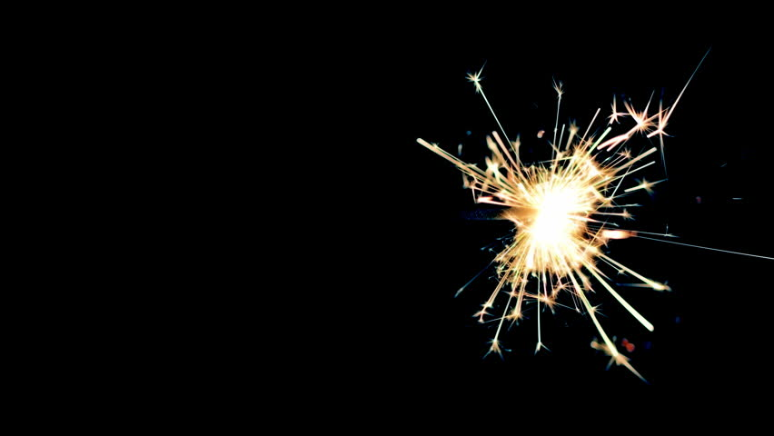 Sparkler burning from right to left in center of black background.  Recorded in 4K at 24fps.  Post-processing and tints applied.