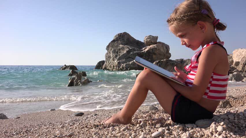 4K Child Playing on Touchscreen Tablet on Beach in Lefkada Island, Greece, Tourist Little Girl Using, Typing, Texting, PC in Summer Vacation, Children, Kids Learning, Studying on Gadgets, Sandy Island | Shutterstock HD Video #9830246