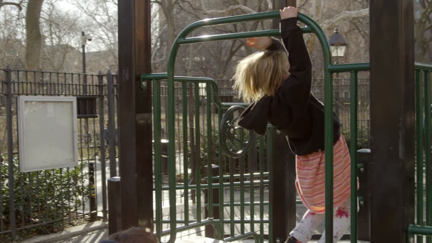 NEW YORK - APR 4, 2015: children play, boy and girl playing on playground in Washington Square Park in 4K slow motion in New York City. Washington Square Park is a public park in NYC.