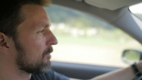 Slow motion of a concerned man driving