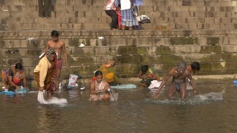 India, varanasi, people bathing in ganges river, february 2015. Varanasi is the spiritual capital of India.