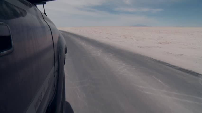 Video footage of a SUV on the salt flat Salar de Uyuni in the Andes of Bolivia | Shutterstock HD Video #9882896