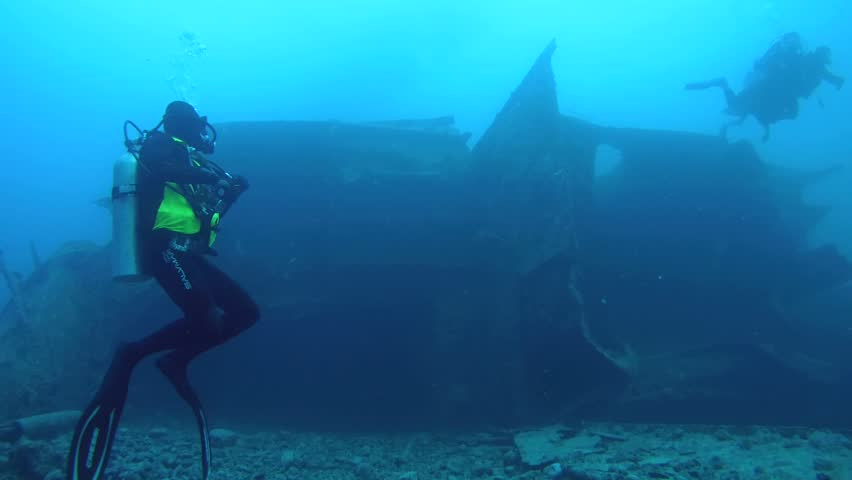 RED SEA, STRAIT OF GUBAL, EGYPT - OCTOBER, 2014:  diver swimming over the wreckage of the wreck SS Thistlegorm, Red Sea, Sharm el Sheikh, Egypt, Sinai   | Shutterstock HD Video #9895640
