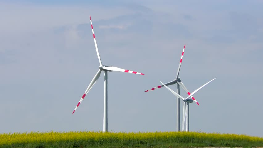 4K footage of wind turbines (aerofoil-powered generators) creating renewable energy. Arrays of large turbines, known as wind farms, are becoming an increasingly important source of renewable energy. | Shutterstock HD Video #9905366